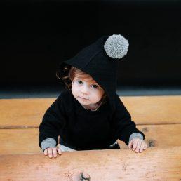 black pom-pom hoodie